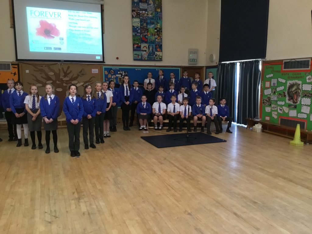 Year 6 lead the Remembrance Assembly