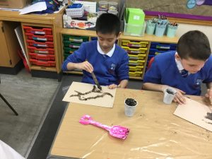 Year 6 experience painting 30,000 years ago!
